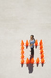 Woman inside box of traffic cones