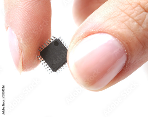 Microprocessor on girls fingertip - 15499556