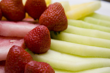 strawberries on melon slices