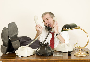 stressed businessman talking by phone