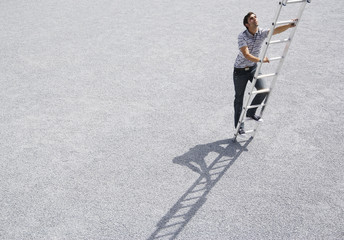 Man climbing ladder outdoors