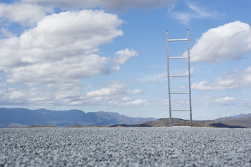 Ladder outdoors with blue sky and clouds