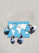 Aerial View of four people doing world map puzzle