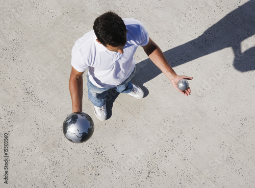 Aerial View of man holding large and small globes outdoors