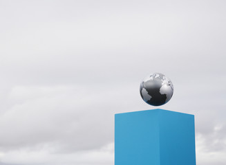 Globe on pedestal outdoors