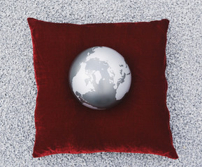 Globe on cushion outdoors