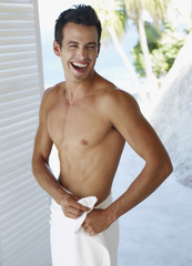 young man with towel around waist