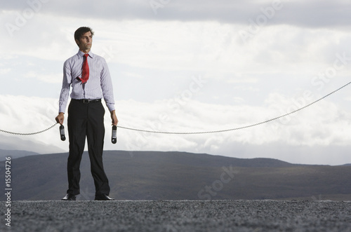 Man outdoors with telephone receiver