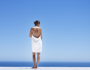 Woman outdoors with ocean backdrop