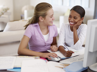 Two young girls doing homework