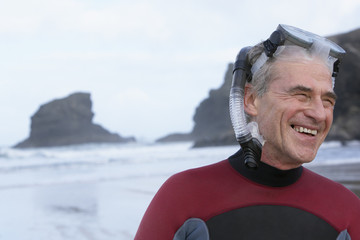 man wearing a snorkel on a beach