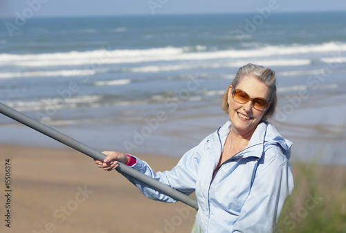 senior woman on outdoors stairs at the beach