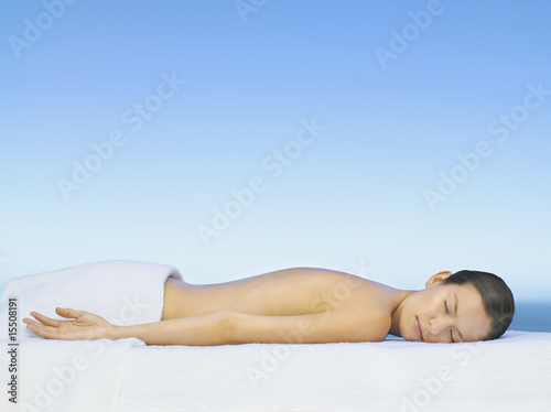 Woman relaxing on a massage table