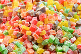 Fruited Turkish delight in various colours as background poster