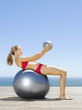 Woman working out with two exercise balls