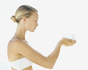 Woman holding an orb in her hands