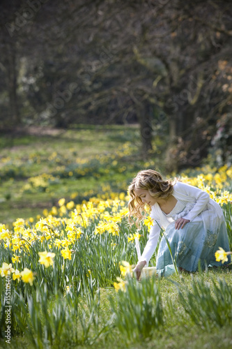 Young Girl Collecting Easter Eggs