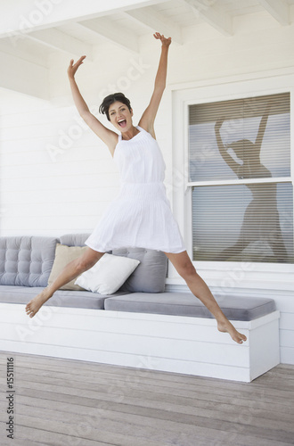 Woman jumping on a terrace