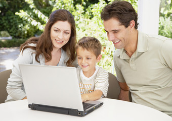 A family working together at a computer