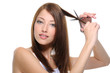 cutting woman's hair with scissors