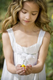 Young Girl Holding Easter Chick Toy