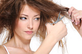 Fototapety female cutting her backcombing brunette hair
