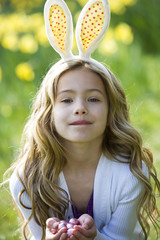 Young Girl Holding Easter Eggs Wearing Bunny Ears