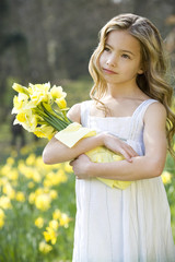 Portrait of Young Girl Holding Bunch of Daffodils