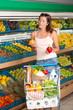 Shopping series - Young woman choosing pepper