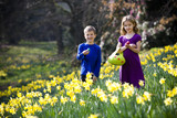 Girl and Boy Holding Easter Eggs