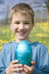 Portrait of Young Boy Holding Easter Egg Smiling