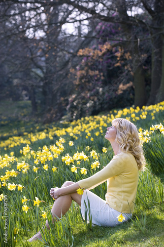 Young Woman Sitting Amongst Daffodils