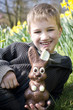 Portrait of Young Boy Holding Chocolate Easter Bunny