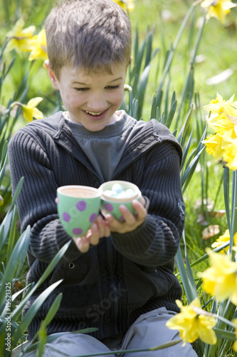 Young Boy Opening Easter Egg Smiling