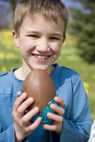Portrait of Young Boy Holding Chocolate Easter Egg