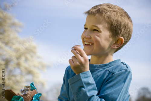 Young Boy Eating Chocolate Easter Egg