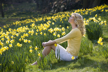 A Young Woman Sitting Amongst Daffodils