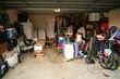 messy abandoned garage full of stuff - 15529715