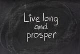 live long and prosper salute on blackboard poster