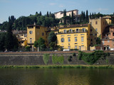 Arno river with Bardini Villa on hill surrounded by cypresses poster