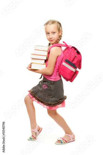 Happy little schoolgirl with a stack of heavy books....