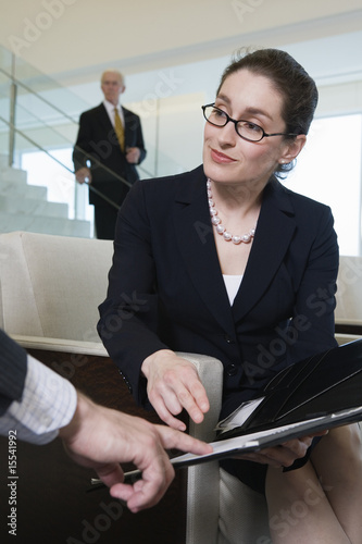 View of businesswoman sitting in an office.