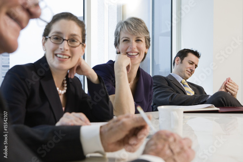 Four business people meeting in a conference room.