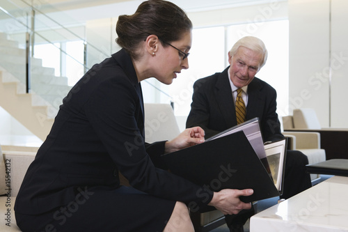 Businesswoman and senior executive discussing presentation.