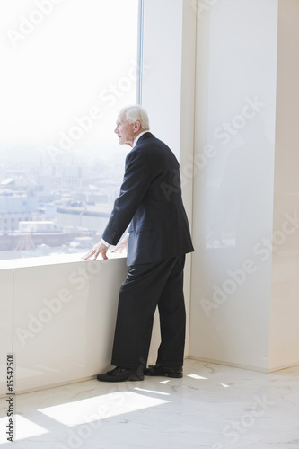 Senior businessman looking out into distance.