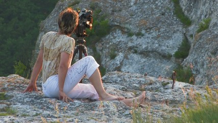 videographer on sunset mountain HD