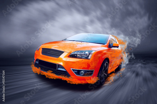 Foto op Canvas Snelle auto s Beautiful orange sport car in fire