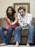 A young couple playing a very intense video game poster