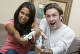 A young couple playing a very intense video game