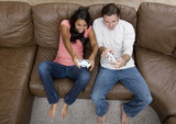 A man and woman playing video games poster